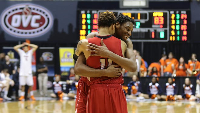 Austin Peay State University seniors Chris Horton (#5) and Khalil Davis (#11) hug as the clock runs out during the Ohio Valley Conference tournament championship against University of Tennessee at Martin on Saturday. Austin Peay became conference champions with a 83-73 win.