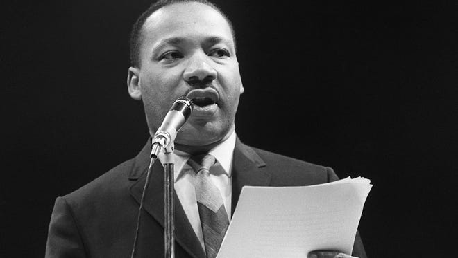 """The US clergyman and civil rights leader Martin Luther King addresses, 29 March 1966 in Paris' Sport Palace the militants of the """"Movement for the Peace"""". """"Martin Luther King was assassinated on 04 April 1968 in Memphis, Tennessee. James Earl Ray confessed to shooting King and was sentenced to 99 years in prison. King's killing sent shock waves through American society at the time, and is still regarded as a landmark event in recent US history.        (Photo credit should read /AFP/Getty Images)"""