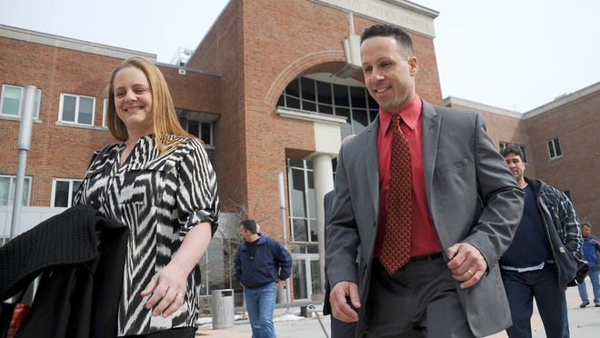 Washington Township Police Officer Joseph DiBuonaventura, right, and his wife, Elise, leave the Gloucester County Justice Complex in Woodbury, N.J., on Tuesday. DiBuonaventura, accused of making a bogus drunken-driving arrest of Assemblyman Paul Moriarty, was cleared of all charges.
