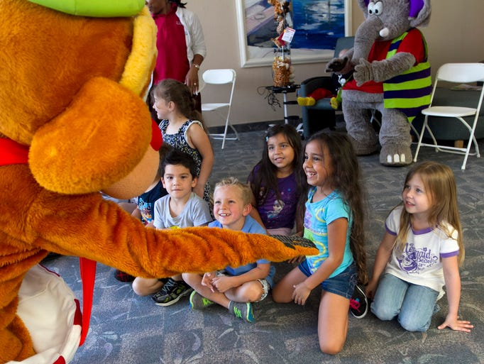 Students from the HealthPark Child Development Center greet Myles of The Fur Circus on Thursday at HealthPark Medical Center. The Fur Circus will perform between periods at the Florida Everblades game on Friday, Apr. 11 at Germain Arena. The characters also visited children who were unable to leave their hospital rooms.
