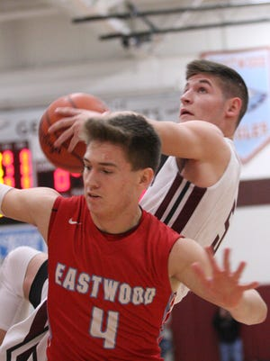 Genoa's Jacob Plantz grabs an offensive rebound Friday over Eastwood's Cade Boos.