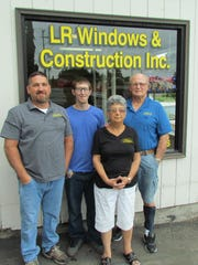 New to Stayton, LR Windows & Construction of Lebanon has set up shop on Tuesdays and Thursdays on the corner of First Ave., and Ida St. Left to right, Lonny Fields, Justin Van Stane, Doreen Van Stane, Randy Van Stane.