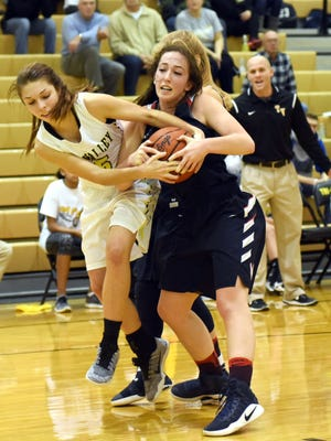 Tri-Valley's Lauren King, left, and Morgan's Braydee Smith fight for possession during the Scotties' 42-29 win on Saturday in Dresden.