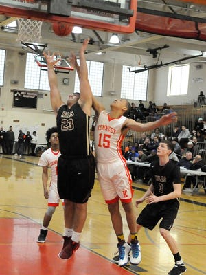 Junior Jason Medak of Wayne Hills shoots, with Kennedy sophomore Gemir Robinson going for the rebound, during the 2017 Passaic County Basketball Championship Semi-final at John F. Kennedy High School in Paterson on Saturday, February 18, 2017.