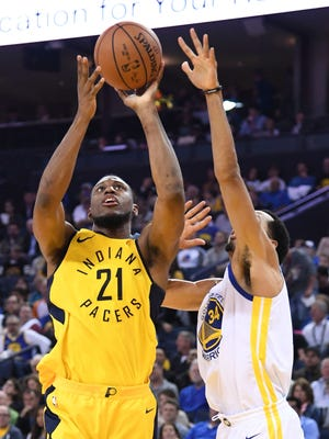 March 27, 2018; Oakland, CA, USA; Indiana Pacers forward Thaddeus Young (21) shoots the basketball against Golden State Warriors guard Shaun Livingston (34) during the second quarter at Oracle Arena. Mandatory Credit: Kyle Terada-USA TODAY Sports