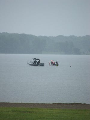 Rescue crews from the Ohio Department of Natural Resources and Orange Township using SCUBA and sonar to search Alum Creek Lake for the body of a boater who went overboard Sunday eveniing. Shot June 5.