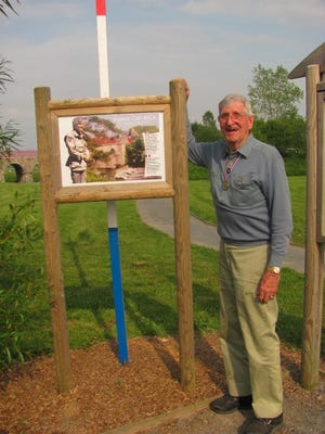 Carl Beck visits a park named in his honor in the Normandy town of Baupte.