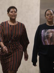 Leticia Astacio, left, arrives in court for in October,