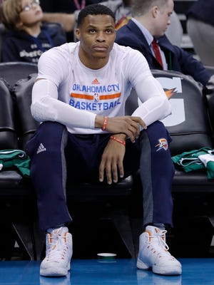 Oklahoma City Thunder guard Russell Westbrook (0) before the start of an NBA basketball game against the Boston Celtics in Oklahoma City, Sunday, Dec. 11, 2016.