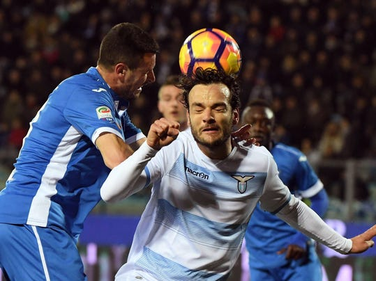 Lazio's Marco Parolo, right, vies for the ball with Empoli's Manuel Pasqual during a Serie A soccer match in Empoli, Italy, Saturday, Feb. 18, 2017. (Claudio Giovannini/ANSA via AP)