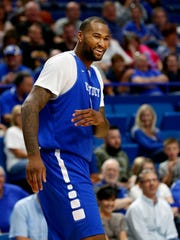 Demarcus Cousins cracks himself up during Kentucky's Alumni game. 