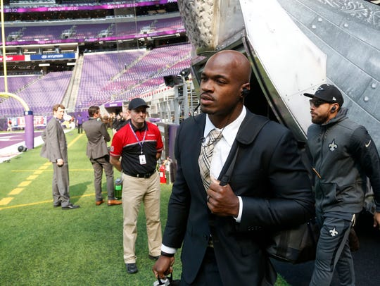 New Orleans Saints running back Adrian Peterson walks