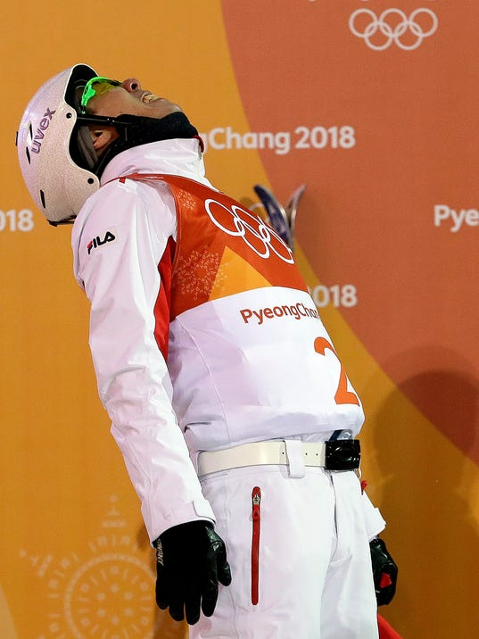 Silver medal winner Jia Zongyang, of China, reacts after his final run during the men's aerial final at Phoenix Snow Park at the 2018 Winter Olympics in Pyeongchang, South Korea, Sunday, Feb. 18, 2018. (AP Photo/Kin Cheung)