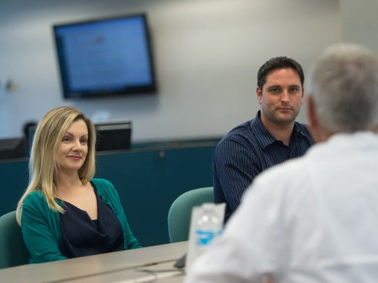 Eve Samples (left), the opinion and audience engagement editor for Treasure Coast Newspapers, and Adam Neal (center), news director for Treasure Coast Newspapers, listen to Bob Brunjes, president and publisher of Treasure Coast Newspapers, during a meeting Jan. 4, 2017 at The Stuart News office in Stuart.