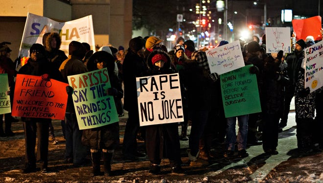 Protesters demonstrate outside the Hamilton Place Theatre ahead of a performance by Bill Cosby in Hamilton, Ontario, on Jan. 9, 2015.