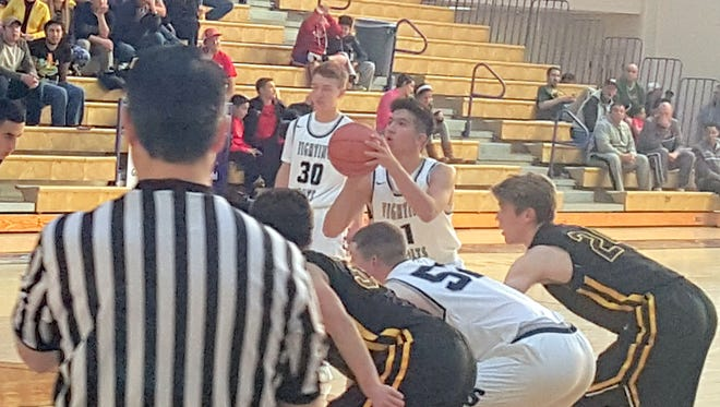 Silver's Josh Saenz shoots a free throw at the Stu Clark Invite during the first game against St. Pius.
