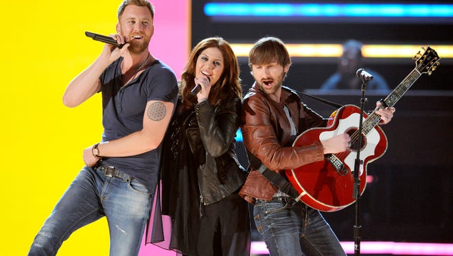 Lady Antebellum, from left, Charles Kelley, Hillary Scott and Dave Haywood,  at the 2013 Academy of Country Music Awards in Las Vegas.