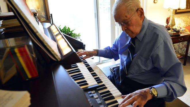 Ambrose LeVan, 105, of Freehold, N.J., still swims and plays the organ.