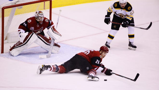 Arizona Coyotes Michael Stone dives in front of the puck against the Boston Bruins in the 1st period on Saturday, Nov. 12, 2016 in Glendale.