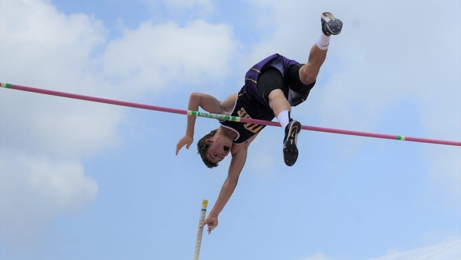 Wylie's Kylor Aguilar starts to let go of his pole after clearing the bar during the Class 4A boys pole vault at the UIL State Track and Field Championships at the University of Texas' Mike A. Myers Stadium in Austin on Saturday, May 12, 2018. Aguilar won silver with a jump of 15 feet.