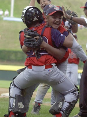 In this picture Guam pitcher Derwin Aguon, right, hugs catcher Alejandro Diaz as other teammates celebrate their 6-5 win over Mexico on Aug. 18 in South Williamsport, Pa. The victory was Guam's first on an improbable trip to the international semifinals.
