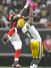 Green Bay Packers cornerback Sam Shields breaks up a pass attempt to Atlanta receiver Julio Jones during an Oct. 9, 2011 game at the Georgia Dome in Atlanta.