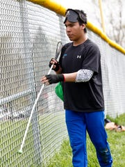 Miquel Tello uses his cain to leave the Indianapolis Thunder  Beepball practice at Broad Ripple Park in Indianapolis, Saturday, April 18, 2015.
