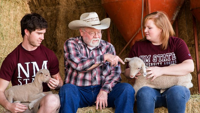 NMSU animal science professor Dennis Hallford speaks to Kaleb Cleckler and Jalayna Roberts about sheep.