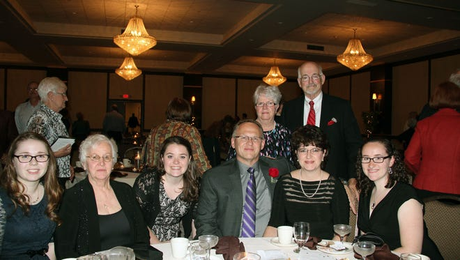 2014 Chenango Valley Distinguished graduate Kenneth Gay, the only man at the table, with his family at the 2014 Distinguished Alumni Recognition Reception