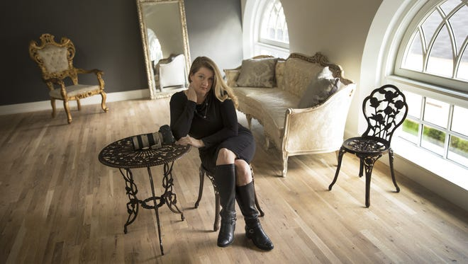 Cate Scaglione sits in her Life as Fine Art Studio in Red Bank.