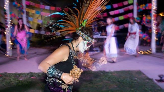 Veronica Valadez of the Aztec Dancers performs at a Dia de los Muertos celebration at Buena High School last year.