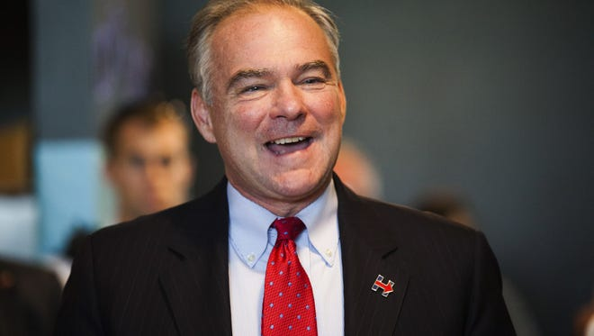 Democratic vice presidential candidate Sen. Tim Kaine, D-Va., visits Hillary Clinton's campaign office on Wealthy Street in Grand Rapids, Mich., Friday, Aug. 5, 2016.