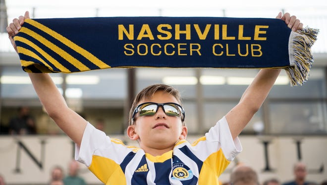 Nashville SC fan Matthew Ward, 13, cheers against South Carolina United FC during a game at Vanderbilt Soccer Stadium on July 1.