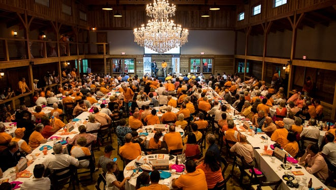 """Tennessee football coach Butch Jones speaks with """"The Voice of the Vols"""" Bob Kesling during a Big Orange Caravan event Monday, July 10, 2017, at The Barn at Sycamore Farms in Arrington."""