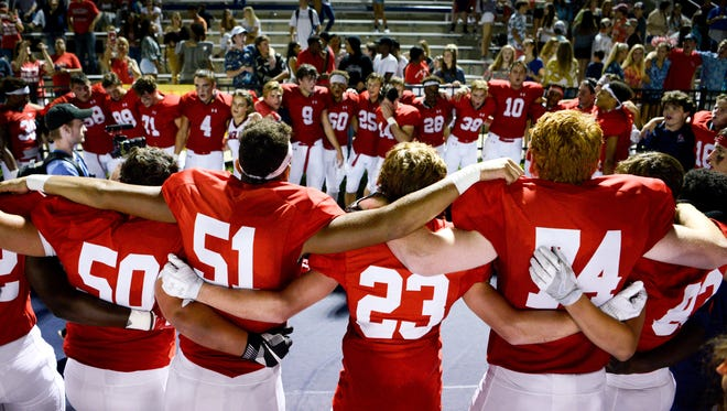 Brentwood Academy players gather after their victory against Hillsboro on Friday, Aug. 18, 2017.