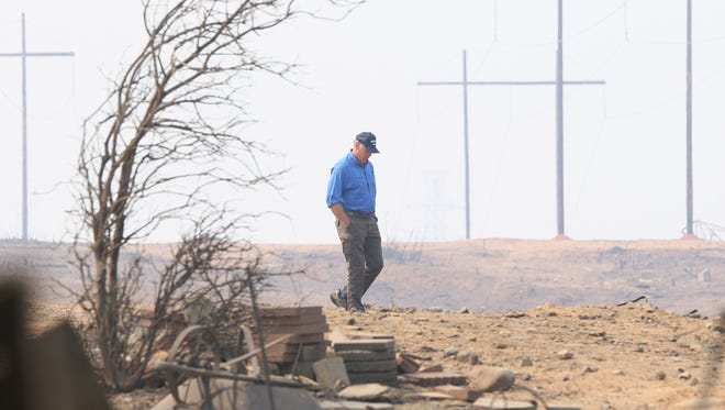 Secretary of the Interior, Ryan Zinke, walks toward the houses that were destroyed by the Carr Fire in west Redding on Sunday.  ///Secretary of the Interior, Ryan Zinke , tours the fire damage at the town of Keswick, and Whiskeytown Recreation Area on Sunday morning./// (Special to the Record Searchlight photo by Hung T. Vu)