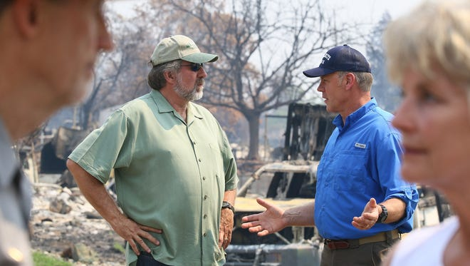 Secretary of the Interior, Ryan Zinke, talks with U.S. Representative, Doug Lamalfa, at the corner of Puffin Way and Cape Cod Dr. while touring houses that were destroyed by the Carr Fire in the Keswick Dam Road area by Quartz Hills Rd. on Sunday morning.