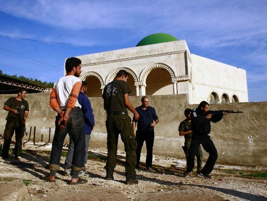 SYRIA-CONFLICT-SPAIN-REBELS-MILITARY