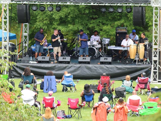 "Reggie Page, of 496 West, performs a saxophone solo during the ""Smooth Jazz in the Garden"" music festival at Schedel in Elmore on Saturday."