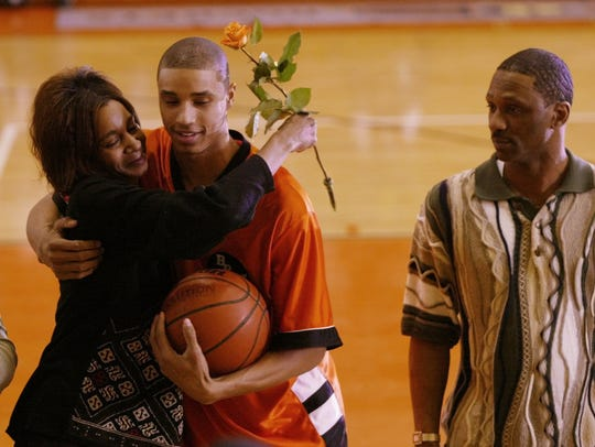 George Hill (middle) gives a hug to his mother Tina