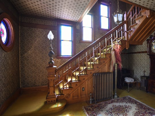 The staircase and newel post inside an 1887 Victorian