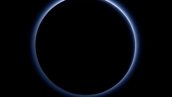 NASA's New Horizons probe returned its first color images of Pluto's atmospheric haze, to the delight of researchers.