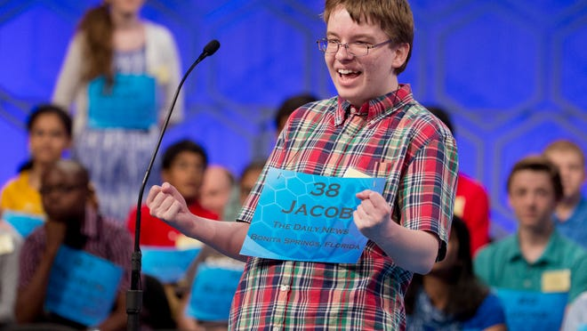 """Jacob Williamson of Cape Coral pumps his fists after hearing his word """"euripus"""" during the 2014 semifinals of the Scripps National Spelling Bee. Pinchers will sponsor the Lee County spelling bee in 2019 after the local competition dropped this year without a sponsor."""