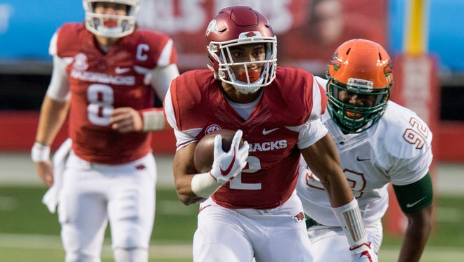 Arkansas running back Chase Hayden (2) runs down the field as Florida A&M defensive end Atreus Martin (92) pursues on Aug. 31, 2017.