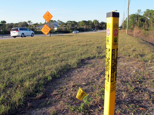 New underground natural gas lines, designated by yellow markers, were installed on the east side of Vanderbilt Drive north of Wiggins Pass Road in North Naples.