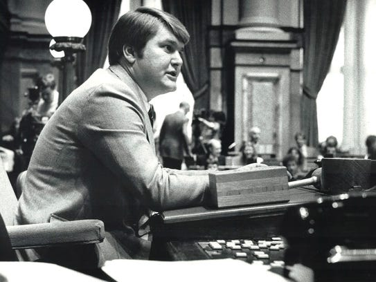 Donald Avenson sits at his desk in the Iowa House chambers