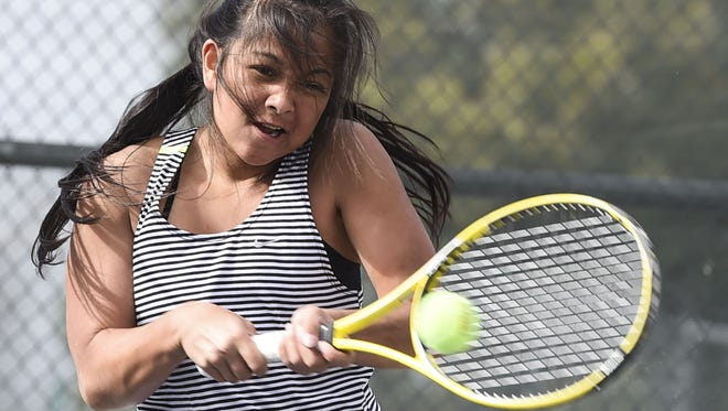 Fossil Ridge's Shawnea Pagat hits in a match last season. Pagat is one of several strong players for the SaberCats, who finished third at state last season.