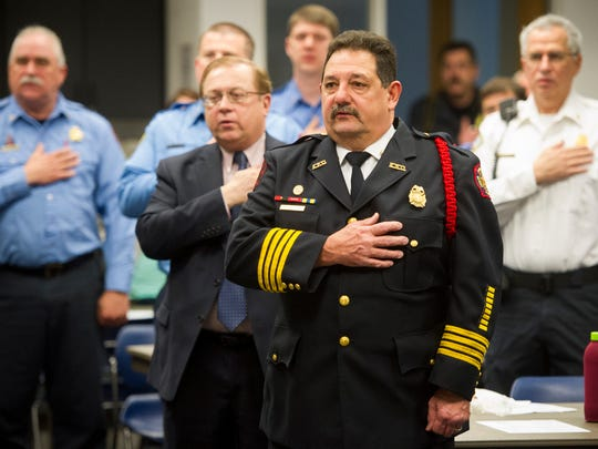 Battalion Chief Dan Grimm recites the Pledge of Allegiance during the Green River Kiwanis 2016 Firefighter of the Year award ceremony at the American Red Cross building in Evansville, Wednesday, March 22, 2017.