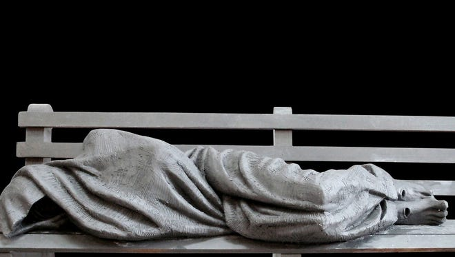 Homeless Jesus sculpture by Ontario-based Timothy Schmalz. The statue is seven-feet long and is cast in bronze. An anonymous donor wants to place the sculpture in Detroit.
