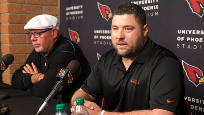 Cardinals new defensive coordinator James Bettcher (right) speaks as Cardinals head coach Bruce Arians looks on during a press conference introducing Bettcher as the new defensive coordinator at the Cardinals' training facility in Tempe on Tuesday, February 10, 2015.